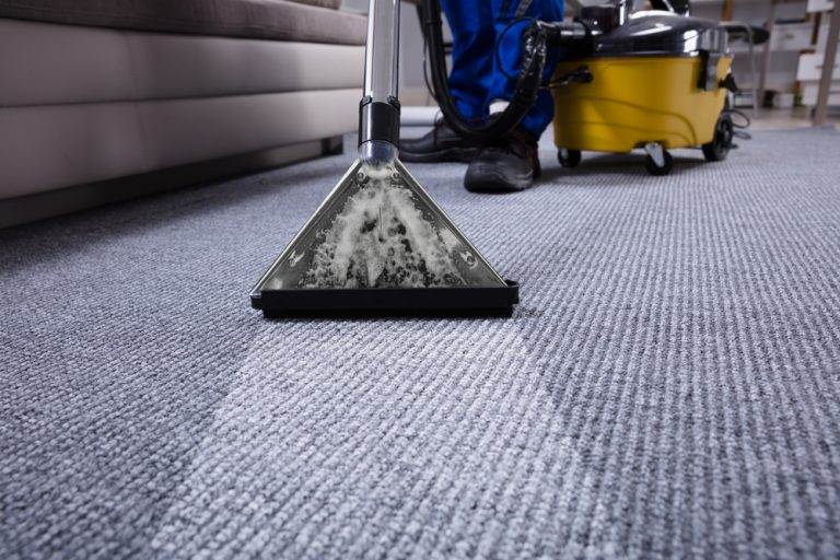 janiter doing commercial carpet cleaning