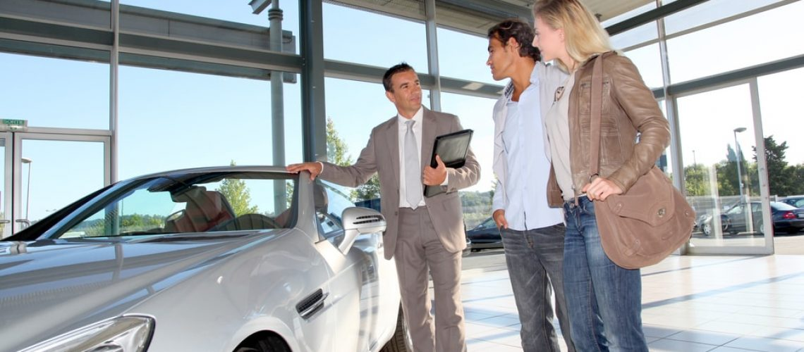 Car Dealer With Customers after receiving commercial cleaning services